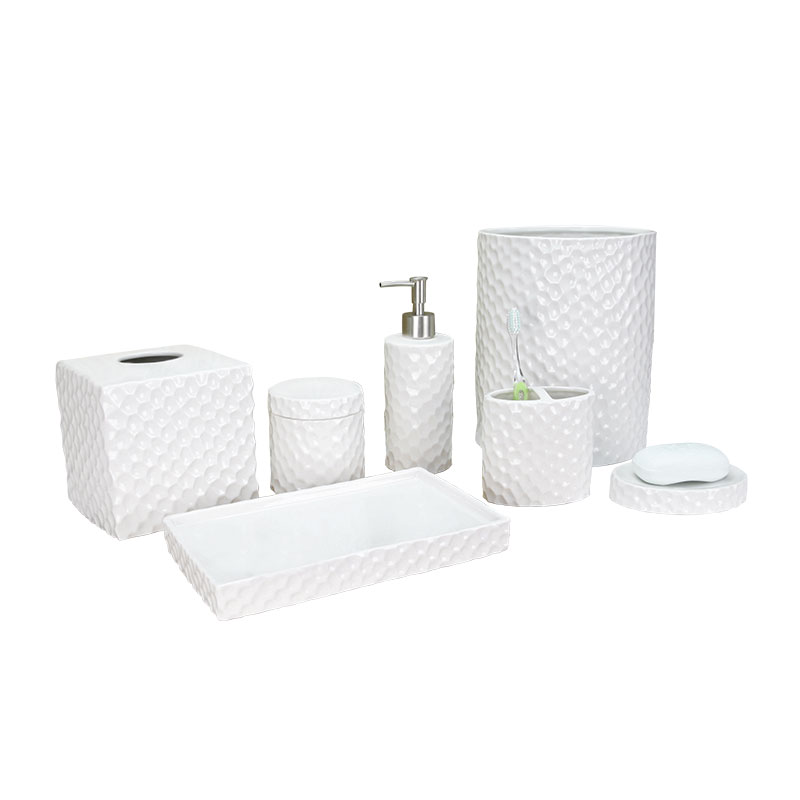 White ceramic face-cut bathroom accessory set